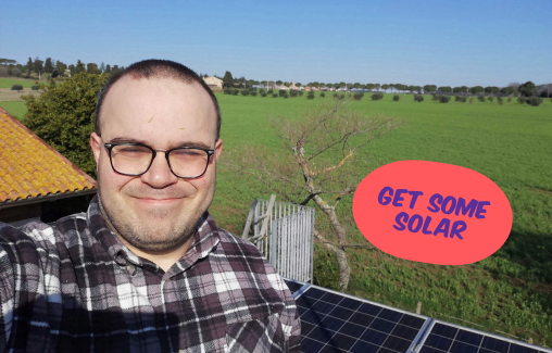 Man stood in front of newly fitted solar panels, Get some solar
