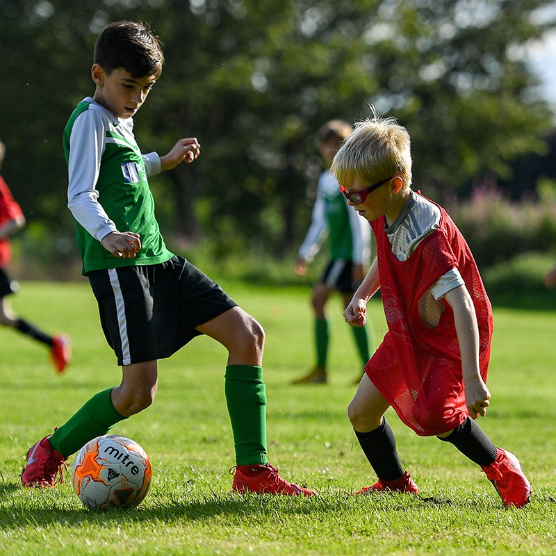 Two boys playing football
