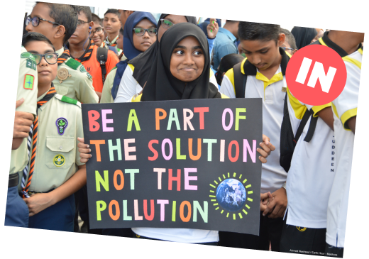 scout troop holding sign saying 'be a part of the solution, not the pollution'