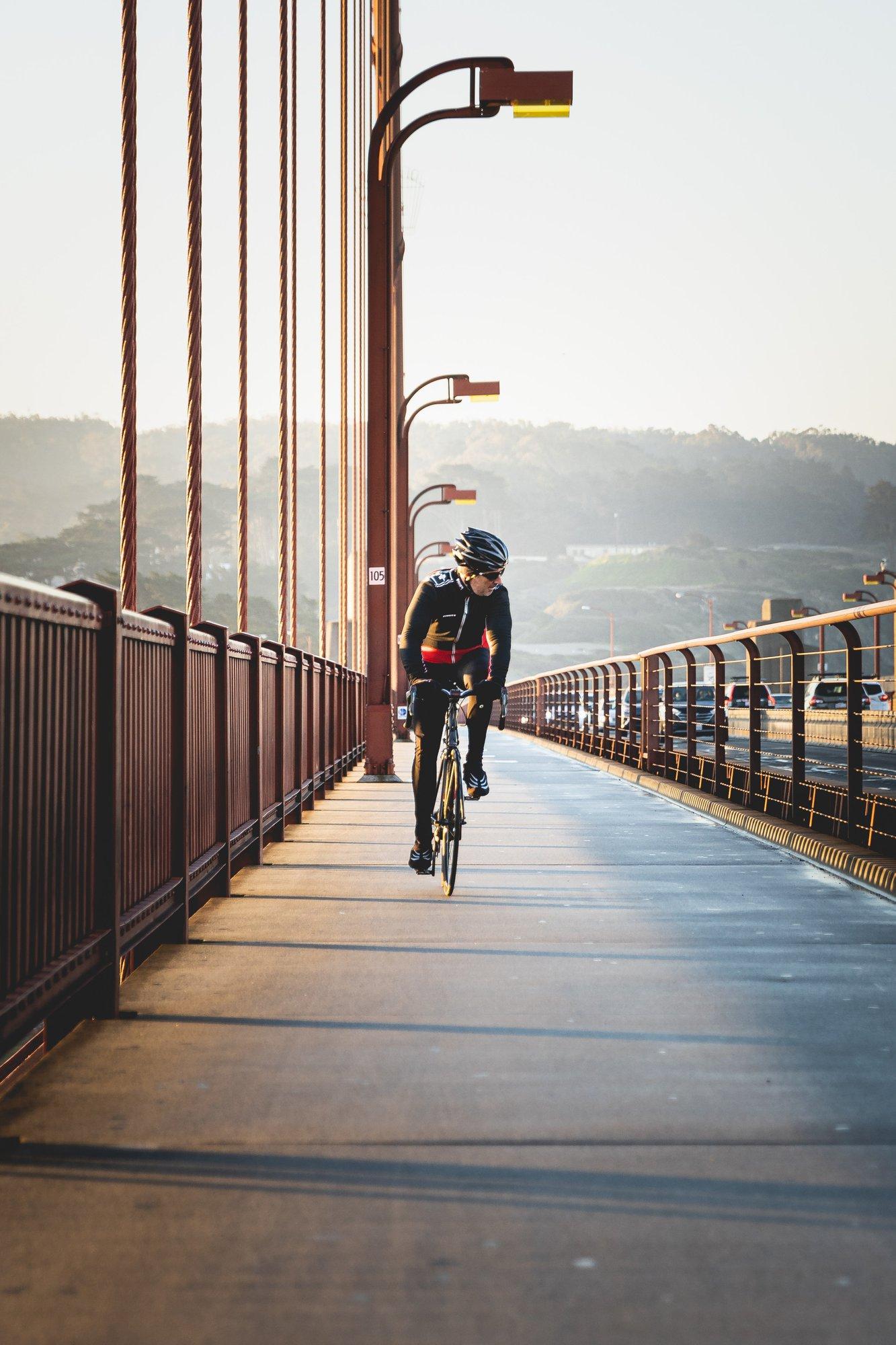 man-riding-a-bicycle-on-bridge-3722760.jpg