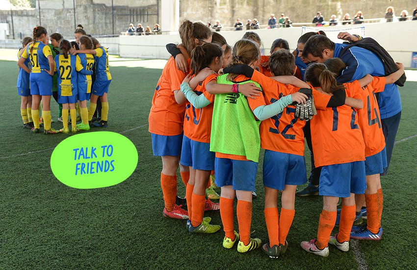 Group of young football players in a huddle with Talk to friends sticker