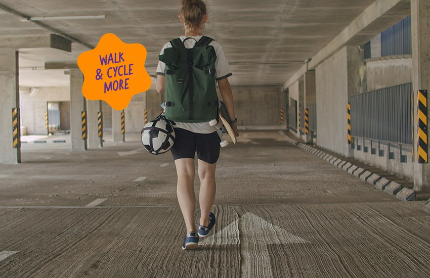Person walking with skateboard under arm with walk and cycle more sticker